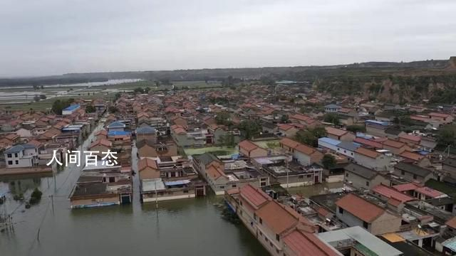被淹没的村庄:三道防线难抵洪水